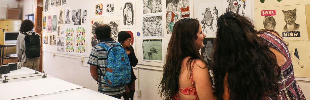 Campus community members look at art in an Open Studio gallery